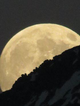 Moon over Swiss Alps